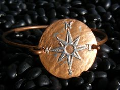 Compass Rose Bracelet. #EtchedQuarter. #TravelerBracelet #ExplorerBracelet #GypsyBracelet #CustomCompass #ManMadeDesign #EtsyJewelry #compassbracelet #compassrose #travelerbracelet #travelbracelet #mapbracelet #traveljewelry #wanderlustbracelet #gypsybracelet #wanderlust #travel #worldbracelet