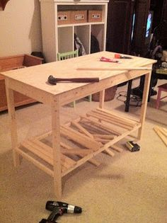 DIY fabric cutting table. separate, removeable ironing board top-- don't forget to add hooks on the side for rulers!