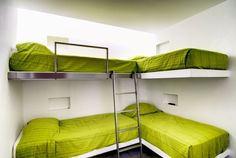 Minimalist White Bunk Beds for 4 Kids with Green Bedding and Glossy Metal Ladder