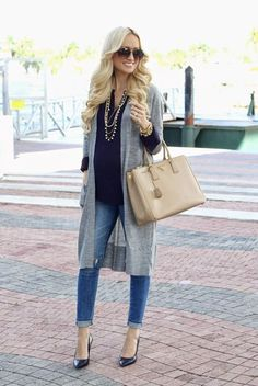 How to Wear a Long Cardigan: Layer a long cardigan over a top and skinny jeans. Cuff the skinny jeans so a bit of ankle peeks out.