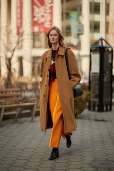 The Best Street Style Moments From New York Fashion WeekFall 2018 - Stand Out with Bright Orange from InStyle.com