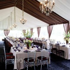 It rained the day of the wedding, so the tent was a welcome part of the surroundings. For an organic look to match the apple-orchard setting, natural linens, and chocolate-brown rattan chargers topped the long dining tables.