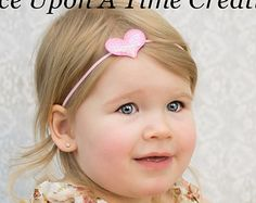 A light pink elastic headband, made with two black shabby flowers, and a fuzzy pink poodle center. Super cute for party favors, outfit matching, and pairing with poodle skirt costumes!  These headbands can be made to fit newborns through adults. Please specify sizes/ages of recipient(s) at check out!  Headband sizing:  Preemie - 13 0-3 Months - 14 3-6 Months - 15 6-9 Months - 15.5 9-12 Months - 16 12-18 Months - 16.5 Toddler - Adolescent - 17 Adult Size - 18 Hair Clip