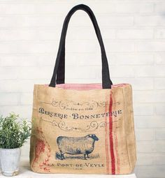 """13""""L x 12""""H x 3""""D. This burlap tote bag features a ticking lining and one inside pocket. Learn more about how we measure our bags."""