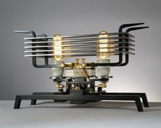 These interesting and unique lamp designs were created by German designer Frank Buchwald. Each lamp is manually produced from up to 200 individual parts. Retro Lighting, Cool Lighting, Lighting Design, Cool Lamps, Unique Lamps, Lampe Tube, Bright Homes, Steampunk Lamp, Steampunk Gadgets