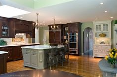 I love the dark cabinets, green walls and white trim. Mod country