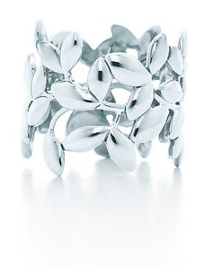 Olive Leaf band ring by Paloma Picasso at Tiffany  Co. --In honor of the ring GP gave me that I lost :(   http://www.tiffany.com/Shopping/Item.aspx?fromGrid=1sku=GRP06619mcat=148204cid=563632search_params=p+1-n+10000-c+563632-s+5-r+-t+-ni+1-x+-lr+-hr+-ri+-mi+-pp+3548+6search=0origin=browsesearchkeyword=selectedsku=30143183