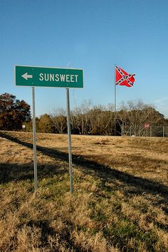 Sunsweet GA Tift County Interstate 75 Exit Sign Large Oversized Confederate Flag Naval Jack Pictures Photo Copyright Brian Brown Vanishing South Georgia USA 2011
