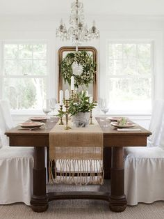 A white farmhouse decorated for #Christmas.