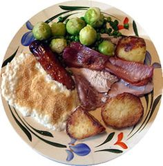 British Foods: A Christmas lunch: turkey, sausage,  bacon, bread sauce, sprouts, potatoes
