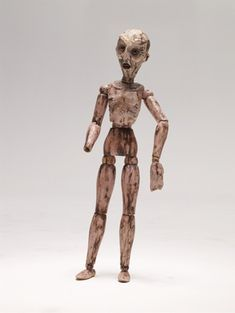 Kurt Cobain's Art.  A whittled and painted artist's wooden mannequin.