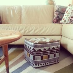 A humble thrift sale footstool made pretty with handpainted tribal designs