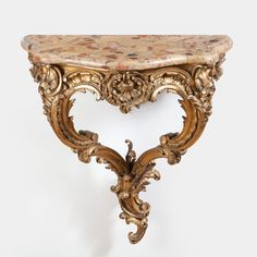 A finely carved mid 19th century Louis XV style gilt wood Rococo console table (France)