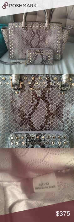 MIchael Kors Large Studded Selma Matching Set 💕 Willing to trade just the bag for another Bag or the set for another set! 💕       MK Large Selma Studded bag and wallet set! Like New Condition. Clean in and out! It comes with the long strap and Dust bag! Blue grey snake skin print with Studded jewels lining the entire bag! Absolutely stunning, rare, and definitely gives off the wow factor! Looking to trade for another Selma but open to other options!  Original Price:   Large Python Studded…