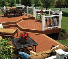 TimberTech® Natural® Deck Boards   Deck Colors: Brick with Brownstone accents RadianceRail System: White with Black Round Aluminum Balusters