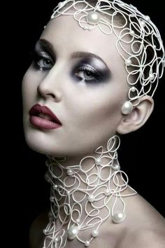 Love the makeup and head accessories.