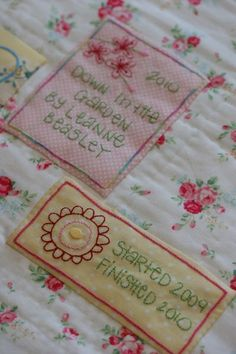 Quilt labels. Gonna make a few myself. They are all hand or machine embroidered.