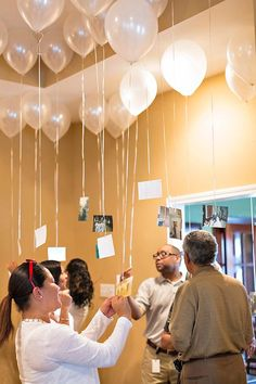 This idea was great, but i was unable to execute... the picture was too heavy. I recommend you tape the balloon to the ceiling. Something to consider. Great idea though!!!!