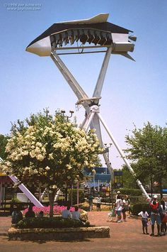 The Looping Starship ride at Astroworld.  =)I went on a similar ride at six flags! Didn't know it was going to twirl upside down when I got on it!