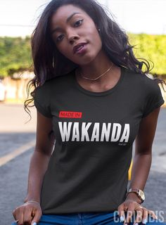 Pictured above is the women's Made in Wakanda tee. Also available in men's/unisex sizing. Visit CARIBIBIS.ETSY.COM to check out more statement tees.