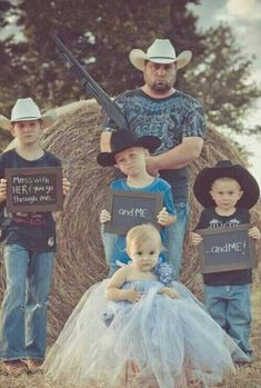 This should be a must photo daddy with his shot gun and big brothers in the back ground hold n up signs say n dont mess with her or youll go though me and the little sister in the front or however u want to do it but this picture should really be a must its so darn cute