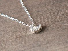 Silver Necklace  Cubic Zirconia Crescent Moon by lilabelledesign, $26.00  Silver Necklace - Cubic Zirconia Crescent Moon, Sterling Silver Chain, Layering - Delicate, Pretty, Dainty, Bridal Party, Christmas Gift  https://www.etsy.com/listing/159415026/silver-necklace-cubic-zirconia-crescent