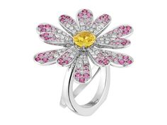 Poiray - Flower Poiray - mounted on white gold and set with diamonds and pink sapphire. 1 carat yellow sapphire central stone. CHF 26'000.-