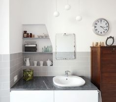 Casa G+S by Grooppo / photographs by Anna Positano / via Dezeen / inset shelving in washroom or kitchen