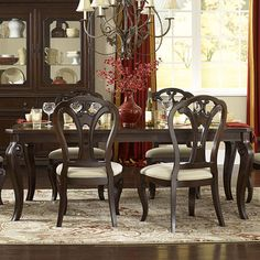 Dark cherry-finished dining table with cabriole legs and an extendable leaf.   Product: Dining tableConstruction Mate...