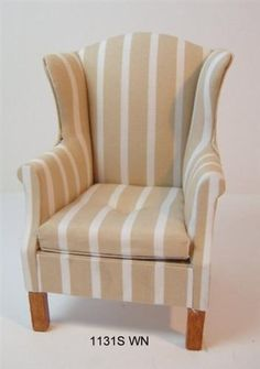 Wing Chair with buttoned cushion upholstered in a cream fabric with a wide Beige stripe. The chair measures 2 7/8 inches high x 2 3/4 inches wide x 2 3/8 inches