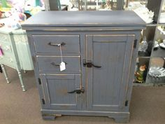 SOLD - Ice box style cabinet offers two drawers and two cabinet doors for storage. The most unique feature is the top which opens to double your serving space. The cabinet measures 31 inches across the front, 16 inches deep and it stands 35 inches tall. It can be seen in booth A8 at Main Street Antique Mall 7260 East Main St ( E of Power Rd ) Mesa 85207  480 9241122open 7 days 10 till 530 Cash or charge 30 day layaway also available