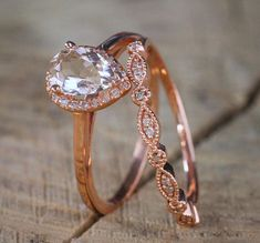On Sale: Save Over $400, Normal Selling Price is $899  NOW ON SALE FOR ONLY $499  A perfect handmade 2 carat Pear shape Morganite and Diamond Halo Bridal Wedding Ring Set in 10k Rose Gold affordable morganite and diamond bridal ring set. The beautiful womens engagement ring is a perfect