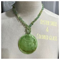 Oyster shell and glass pendant necklace. Oyster shell pendant with colored glass detail. Seafoam green.Chain measures 18 inches long and pendant measures 2 1/2 inches round. Very lightweight and comfortable on your neck. Great for summer. Has adjustable closure for length.   Bundle  in my closet and save. No PayPal's or trade. I ship same day or next day almost always. Suggested user and top-rated seller! Thank you for checking out my. Jewelry Necklaces