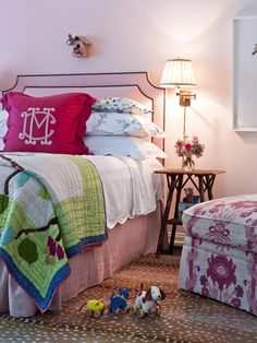 Avrea Wagner Design | Leotine Linens | Shams in white pique with scalloped edge | Euro sham in Fucshia linen with oversized Dorea monogram