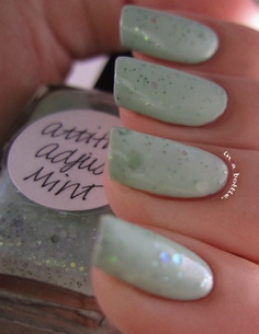 two coats of Lynnderella Attitude Adjust-Mint over 2 coats China Glaze Re-fresh Mint and topped with a coat of SV