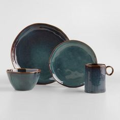 These java-ready gems might just as likely be found in a boutique ceramics shop for twice the price. Each of our exclusive stoneware Indigo Organic Reactive Glaze Mugs is one of a kind, finished with a reactive glaze that shines beautifully in the sunlight while you sip your morning coffee. Makes a superb gift!