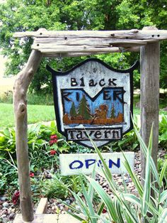 """Hand Carved """"Business"""" Signs; made out of reclaimed barn wood and drift wood found along Lake Michigan in South Haven, Michigan."""