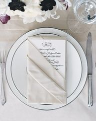 Menu folded in napkin with baby breath or winter berry sprig tucked in!