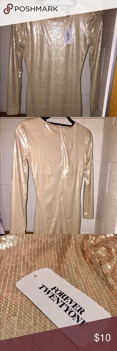 SM gold Forever21 sequin party dress gorgeous all sequin gold party dress, very flattering fit (not too tight, not too loose), has a few sequins that fell off on the right back shoulder- barely noticeable, never worn- tags still on it, bought off clearance for $15 but marked down from $30 Forever 21 Dresses Mini