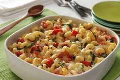 This Italian-style version of mac and cheese is made with grape tomatoes, bacon and thinly sliced fresh basil.