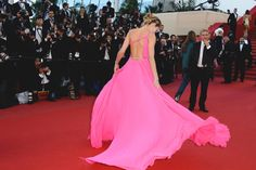 Jessica Hart wearing a backless pink dress at Cannes red carpet 2013.