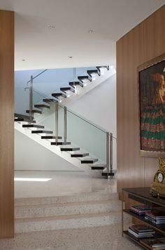 Open wood tread stairs. Glass panel railing.