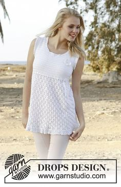 Crochet DROPS tunic with lace pattern, flounce at the bottom and butterfly for decoration in Cotton Viscose. Free pattern by DROPS Design.