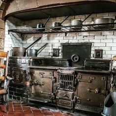 This Gothic kitchen is very rustic. It has old, dark, rustic appliances that fit this type of house very well. It has got rustic white bricks. Wood Burning Cook Stove, Wood Stove Cooking, Kitchen Stove, Old Kitchen, Vintage Kitchen, Kitchen Cabinets, Tv Cabinets, Steampunk Kitchen, Victorian Kitchen
