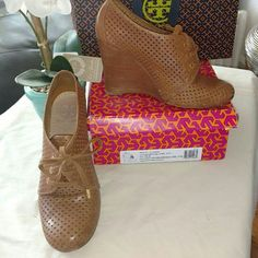 "Tory Burch Lace-up Wedge Brown Tory Burch wedge booties with round toe, stacked wedge and lace tie closure at front. Light scuffing from wear on soles.  Heel measures: 4.25"" RE-Posh since the heel was too high for my aching calves. Tory Burch Shoes Ankle Boots & Booties"