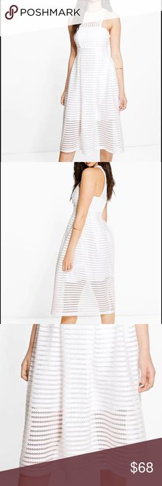 Structured White eyelet skater midi dress Beautiful structured eyelet white dress, partially lined, size 6 100% Polyester. Flat Measurement of Garment: Shoulder To Hem 115cm/45, Bust 36cm/14. Model Wears Size 4/XS ASOS Dresses Midi
