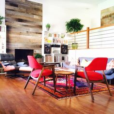 Design Project Install for Atomic Furnishing and Design in Asheville, NC. Mid Century modern meets Rustic. Customer Upholstery, persian rug, reclaimed wood fireplace, and custom built-ins...
