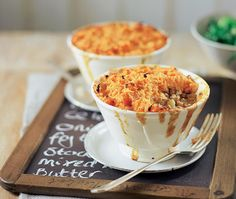turkey mince cottage pie with a sweet potato topping, in an individual bowl, resting on a chalkboard