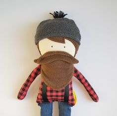 This is a man doll if you have ever seen one. This little guy in inspired from the one and only Paul Bunyan. Being a true blue northern