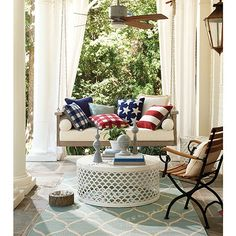 The Americana indoor/outdoor pillows are a simple touch that make this porch festive and spirited for summer. Decor, Outdoor Spaces, House With Porch, Space Decor, Outdoor Patio Decor, Outdoor Furniture, Fourth Of July Decor, Indoor Outdoor Rugs, Ballard Designs